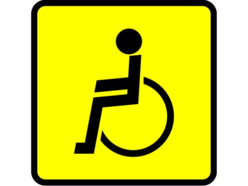 Знак инвалида желтый